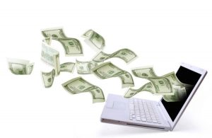 Money pouring out of a laptop symbolizing our successful digital marketing strategy and implementation.
